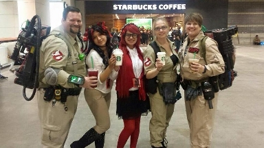 Mya at C2E2 2015, cosplaying Gress Sutcliff from  Black Butler, with a crew of Ghostbusters & a classmate dressed as a cat who's trying to purloin Mya's coffee