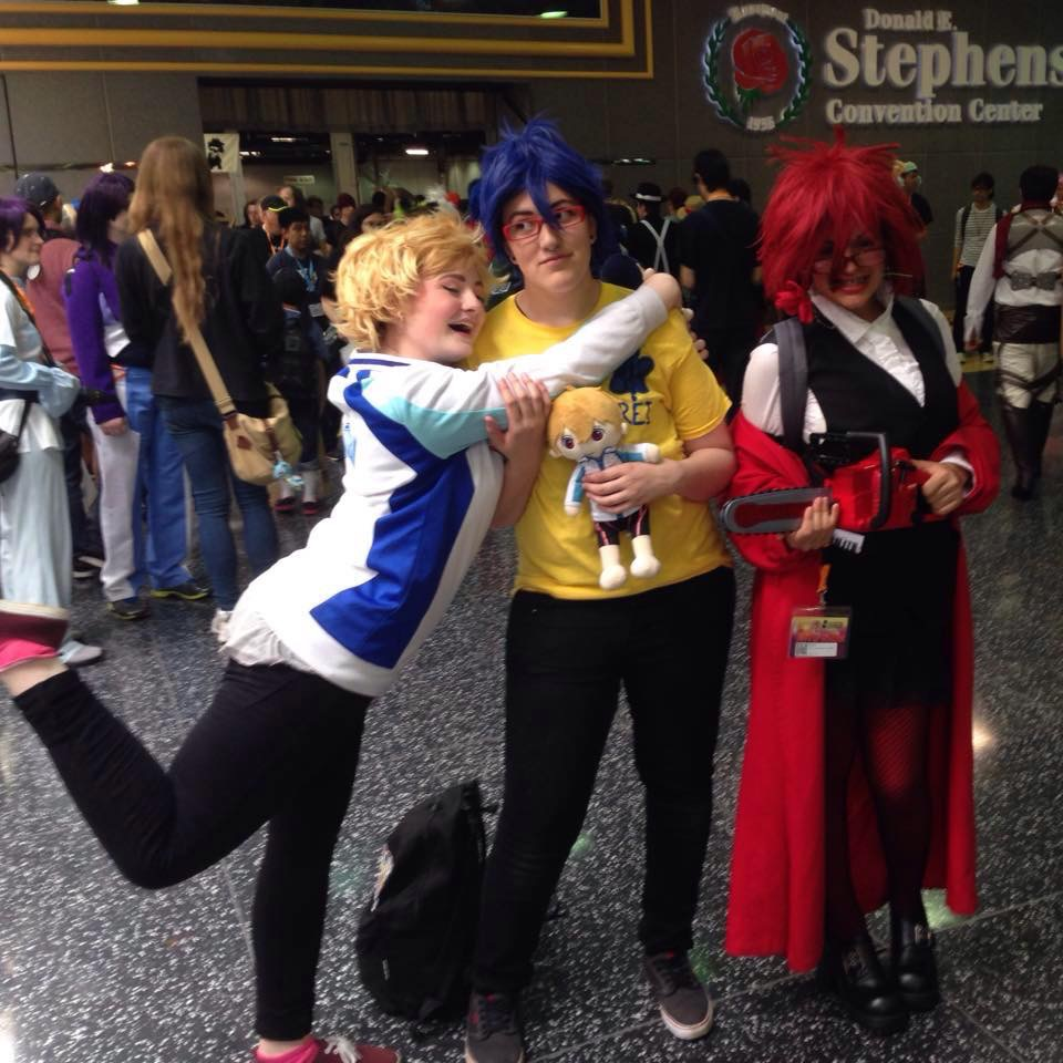 Mya at C2E2 2015, cosplaying Gress Sutcliff from  Black Butler, with a bunch of superheroes, Princess Ariel with Flounder, & a couple of photobombers