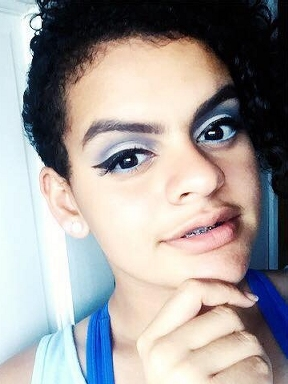 Mya in 2017 expermenting with a crazy-blue makeup