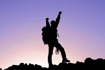 Hiker/climber with arms up in victory