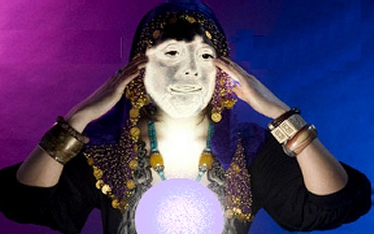 Costumed female fortune teller with crystal ball